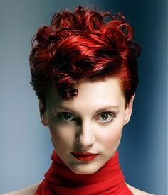 A short red wavy curly coloured womens hairstyle by TPL Hairdressing