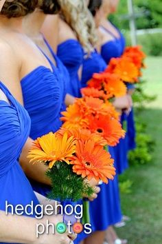 Jessica idea for orange flowers.  Gerber Daisies.  Nice looking against blue dresses.