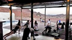 Can you think of anywhere more beautiful than Namibia& ancient, expansive landscapes to conduct a wellness safari? Starting with yoga on the main area deck at Damaraland Camp. Wilderness, Safari, Maine, Landscapes, Deck, Wellness, Camping, Yoga, River