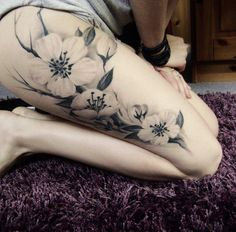 white Flower thigh tattoo. I like the negative space in the tattoo