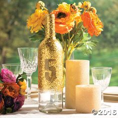 Glittered Bottle Table Number Centerpiece Idea