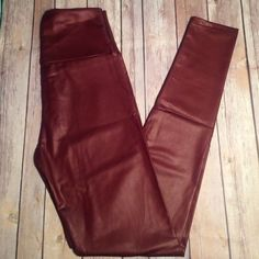 Burgundy brown faux leather leggings Thin and stretchy faux leather leggings! Large waist band to ride high waist 26-30 inches with stretch Pants Leggings