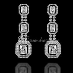 These CZ earrings are beautifully designed with two sizes of emerald cut jewels surrounded by octagonal pave settings. They have a vintage, art deco style perfe