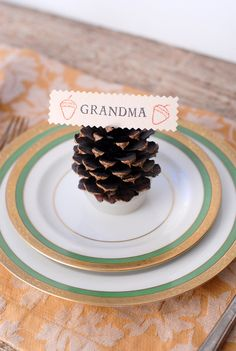 thanksgiving table settings with pinecones - cute...could even use this idea to mark different casseroles and other dishes.
