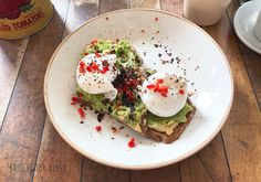 smashed avocado with hummus and poached eggs on gluten-free bread