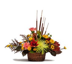 Get ready for Thanksgiving with this perfect arrangement. A Premium Basket Centerpiece that is lush and overflowing with beautiful, rich fall blooms.  It would look lovely on everyone's table!
