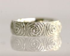 This would be pretty with a simple diamond band alongside it Rose flower wedding band women's single band 14k by TinkenJewelry, $760.00