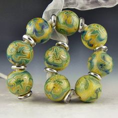 set of 9 rounds in variegated blues with tiny specks of fine silver handmade lampwork glass beads - Faded Denim