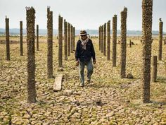 Drought around the world 2016 - LAMPANG, THAILAND On March 31, 2016, a farmer walks through dried up Mae Chang Reservoir.