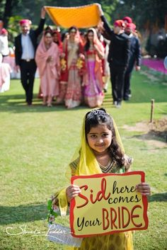 What's better than one of your flower girls holding a cute 'here comes the bride' sign. Be creative even for your indian wedding entrance - plus, DIY this sign Bride Entry, Wedding Entrance, Desi Wedding, Wedding Bride, Wedding Dresses, Wedding Hair, Wedding Reception, Wedding Mandap, Temple Wedding