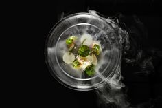 """As part of its involvement with Art Basel Hong Kong, the Mandarin Oriental Hong Kong's executive chef Uwe Opocensky created a series of dishes inspired by iconic works of art. That included the Lily Pond—Alaskan king crab, scallop, dashi, and frozen grapefruit—designed as an ode to French impressionist Claude Monet's """"Water Lilies.""""  Photo: Courtesy of Mandarin Oriental Hong Kong"""