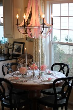 V Day tablescape. Love the fabric and streamers  on the chandelier.