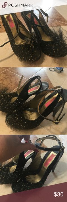 Betsey Johnson heals Beautiful black with gold dots and a tool bow on top of shoe . Toe is a peek a boo cut out . Straps wrap around ankle . Gently used good condition . Bottom of shoe shoes very little wear .. only worn once . Betsey Johnson Shoes Heels