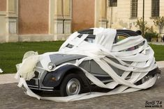 The classic toilet paper look :)  - Wedding Vehicle Decorations