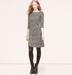 """A striking dropped leaf print - and pretty pleating at the waist - makes this super soft style an endless flatterer. Boatneck. Long sleeves. Pleated at side waist. Back zip. Lined. 21"""" from natural waist."""