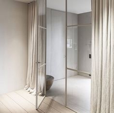 Vincent Van Duysen, glass partition, linen drapery