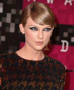 Pin for Later: 15 Halloween Beauty Costumes That Begin With a Bold Cat Eye Taylor Swift