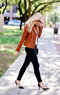 Heather's structured moto jacket dresses up her frayed black denim.