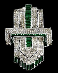 Trifari clip mates Art Deco pave buckle pin brooch clip with emerald channel set baguette jewels.