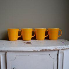 yellow glass mugs