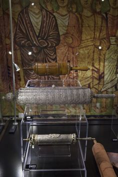 These silver and wooden cases house Megillah, or Esther, Scrolls. The Book of Esther has an important place in Judaism, being used for both private and corporate worship. The Esther Scroll is read in the Jewish household on the Feast of Purim, a holiday that celebrates God's deliverance of the Jewish people from the Persian plot to exterminate them told in the Book of Esther.