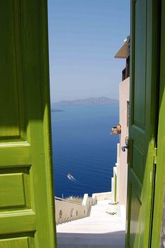 I'd kill to have this as the view from my front door!! Also looooove the color of paint in comparison to the white stucco and blue ocean and sky, so relaxing.