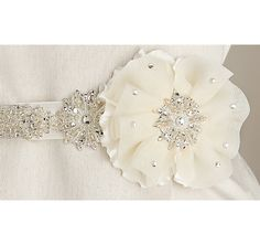 The Two Layered Flower and Bead Wedding Sash features an elegant satin and netting flower design with crystal accents on a white or ivory satin ribbon. http://www.theweddingoutlet.com/Bride/Bridal-Sashes/Two-Layered-Flower-and-Bead-Wedding-Sash