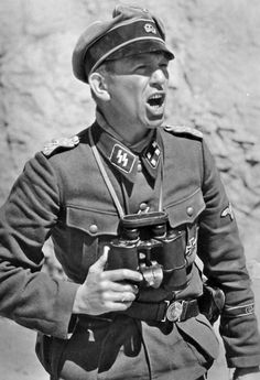 During 1941, SS-Sturmbannführer Kurt 'Panzer' Meyer (photo) became renowned within the German military for devising a unique employment of hand grenades to motivate his troops. Meyer commanded the reconnaissance battalion of the Leibstandarte Division during the Balkan Campaign in the spring of 1941. His battalion was held up at the Klissura Pass, which was strongly held by Greek troops. When murderous Greek defensive fire pinned down Meyer's battalion as it attempted to ...