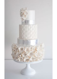 Tender white cake filled with shira & ophelia buttercream butterfly kisses on White Wedding Cake Stand.