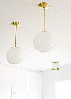 Cedar & Moss pendant lights.  Though these pendants were purchased globes like this can still be purchased at thrift stores and the like and it would be easy enough to DIY.