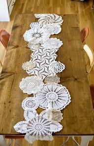 stitching together doilies to make a table runner