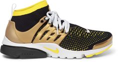 Nike 's 'Air Presto' design is given a contemporary upgrade in Flyknit, ensuring a breathable and lightweight feel. These eye-catching yellow and black sneakers have a flexible sock-style upper surrounded by gold rubber foot cages for additional support. Grey laces, embroidered swooshes and colour-blocked soles round them off. Fits true to size. Take your normal size Yellow and black Flyknit, gold rubber Pull tabs, embroidered swooshes, mesh linings, grey, white and yellow rubber soles…