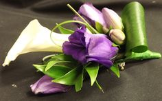 Calla, freesia and lisianthus buttonhole www.weddingflowersbylaura.com