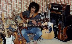 A young Slash in his basement, shortly after giving up pro BMX riding to concentrate on playing guitar. The guitar on the right, a B.C. Rich Mockingbird, was his favourite. He devised his own method of attaching it to his amplifier.