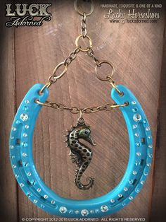 """OCEAN PONY"" is a glossy, turquoise horseshoe with a beautiful seahorse as the centerpiece, accented by delicately placed, sparkling Swarovski crystals. Each Luck Adorned horseshoe is a one of a kind, Horseshoe Projects, Horseshoe Crafts, Lucky Horseshoe, Horseshoe Art, Horseshoe Decorations, Horseshoe Ideas, Church Decorations, Traditional Wedding Gifts, Equestrian Gifts"