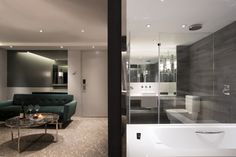 hotel room renovation hong kong 2015 glass walls and stone like tiles for bathroom floors extended to the foyers connect spaces together