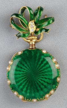 Antique 18kt Gold, Enamel, and Split Pearl Pendant Watch, Tiffany & Co., the white enamel dial with Arabic numeral indicators and subsidiary seconds dial, green guilloche enamel bezel and case with split pearl accents, 30 mm, and suspended from a watch pin designed as a bow with diamond melee accents, case and movement no. 1737583, signed on the dial and movement.