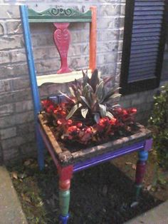Found two of these brightly-painted chairs at a garage sale for only 3bucks each...made perfect planters.
