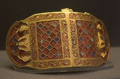 Early Anglo-Saxon shoulder-clasps from Sutton Hoo, early 7th century. Gold, garnet, and millefiori glass.  British Museum