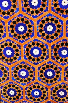 Honeycomb structured tile in orange, blue.  Kalon Mosque, Uzbekistan.