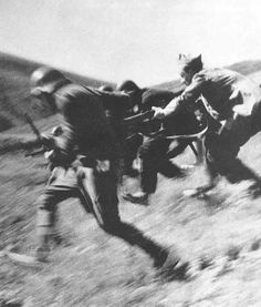 Santa Eulalia, Spain. Republican soldiers during an attack. By Robert Capa, (1936)