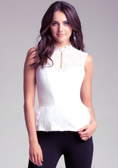 bebe | Feathered Peplum Top - Holiday Catalog  Pair with leather skirt