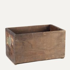 Newcomb wooden crate: Wooden crate with paper scrap on one side.