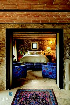 Italian decor and exposed stone walls in a guest Bedroom in La Casa at #CastellodiCasole in #Tuscany #Italy