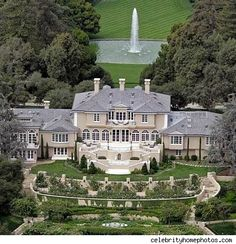 Another view of Oprah Winfrey's house. She traded her $6 million house for a $50 million home featuring 42 acres of land, sea and mountain views, 6 bedrooms, 14 bathrooms and 10 fireplaces!