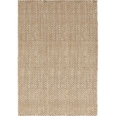 Stylist's Tip: A jute rug is a great way to add natural texture to a space, and its neutral hue means it's a versatile design for any decor. Go for a monochr...