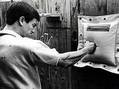 Bruce Lee - wing chun punch. I've done lots and lots of practicing on the rice bag. Love it!