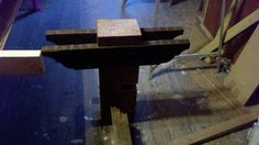 Table legs on both ends of the table.  The old growth rings on top of the table legs are exposed and set flush with the tabletop.