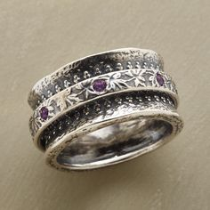 ROYAL WALTZ RING--Sterling silver spinner flower ring, in which a flower-strewn sterling silver circlet, set with amethyst, spins about a sterling band, regally embellished. Exclusive. Whole sizes 5 to 9.