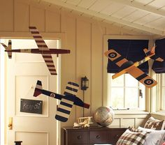 It's so hard to find creative and stylish baby boy decor. I love this airplane mobile - it woudl so grow up with my little boy. #potterybarnkids